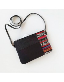 Small black shoulder bag combined with colored tribal fabric